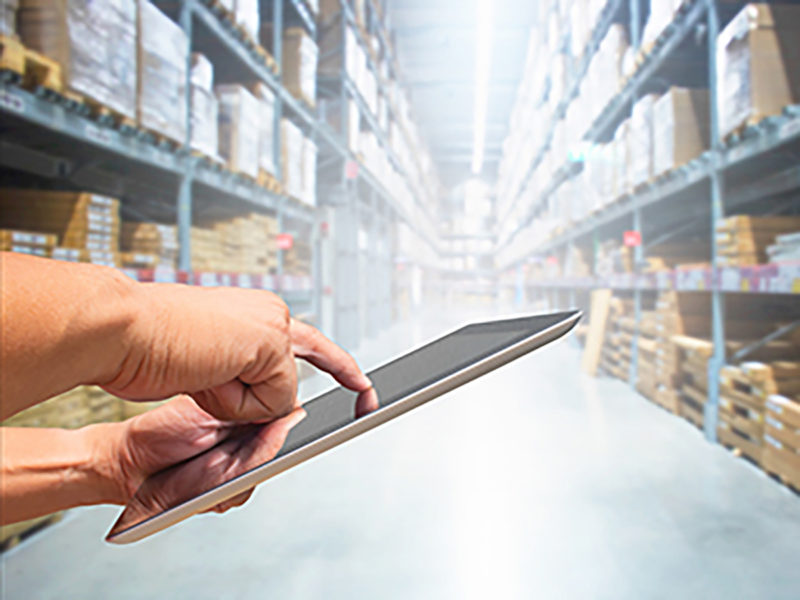 person holding tablet in warehouse