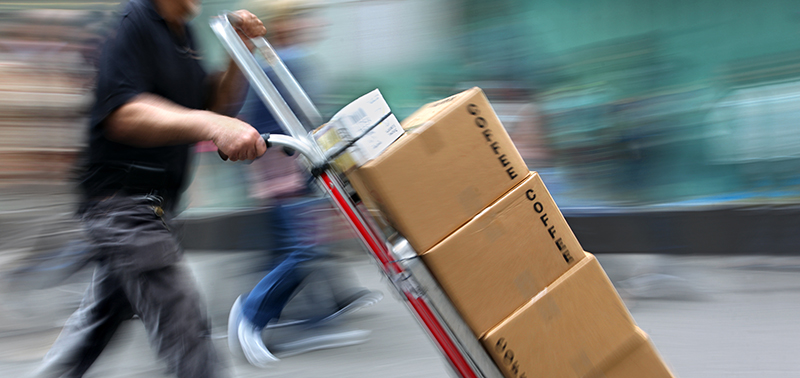 delivery goods with dolly by hand, purposely motion blur
