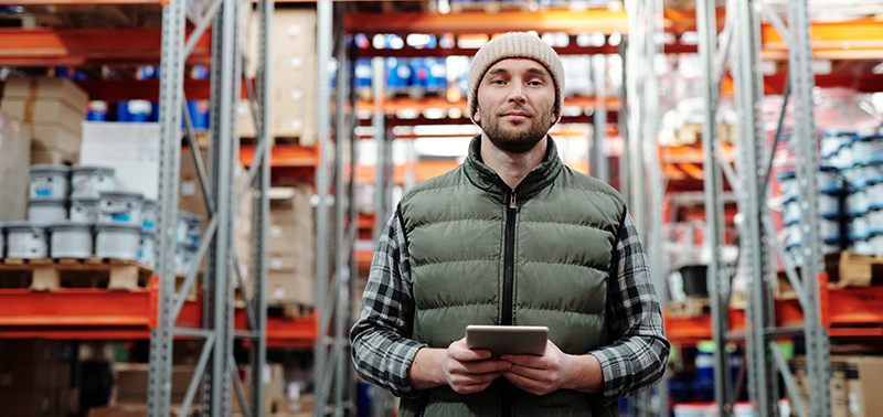 man in warehouse with tablet computer