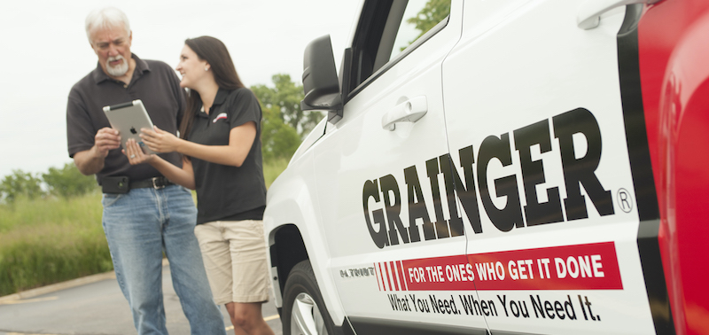 Grainger sales call man and woman outside van.