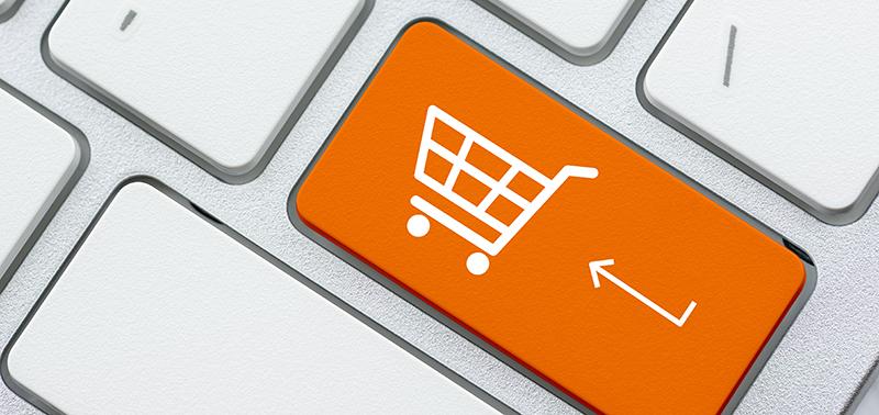 keyboard closeup with orange shopping cart key