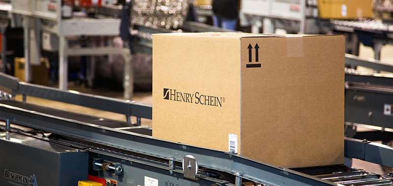 health care distributor Henry Schein box on conveyor belt
