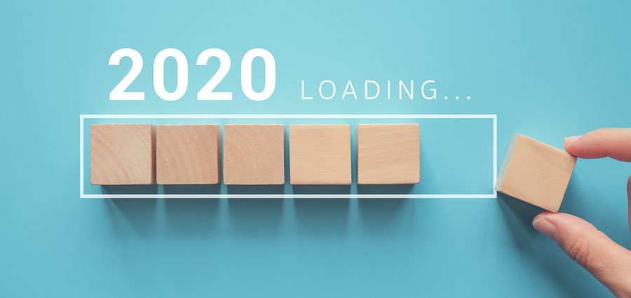 Loading new year 2020 with hand putting wood cube in progress ba