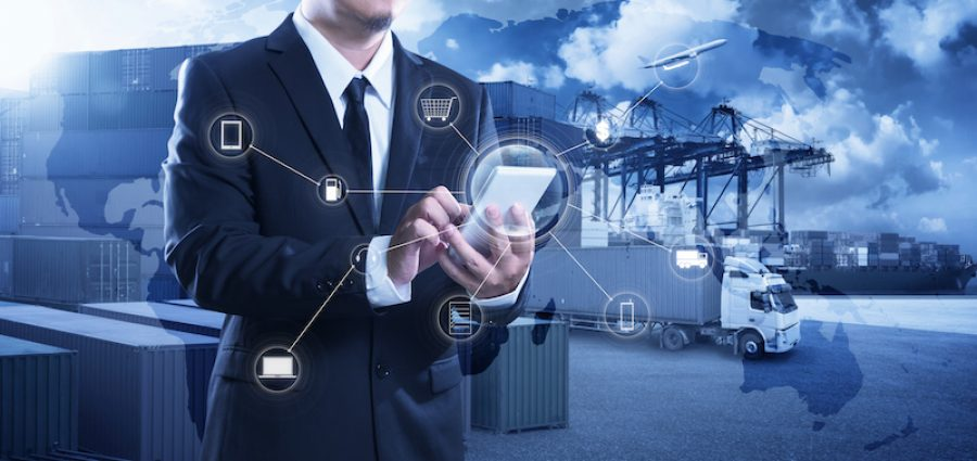 Businessman touching smartphone for analyze stock at logistics port and world map and online goods orders ,logistics network import export transportation trading business concept .