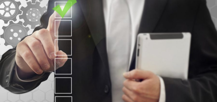 man in suit checking boxes
