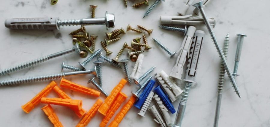 a bunch of multi-colored fasteners
