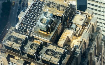 air conditioning units on the roof of a tall building