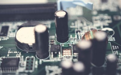 Selective Focus Photo of Electrolytic Capacitors on Circuit Board