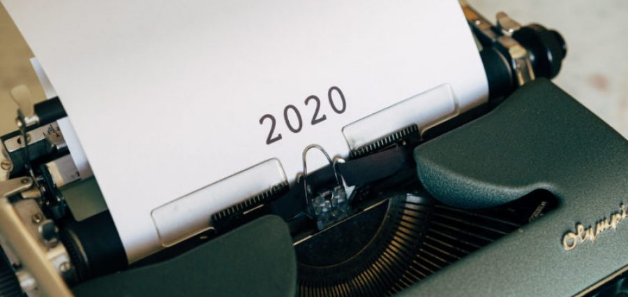 typewrite with white paper showing 2020
