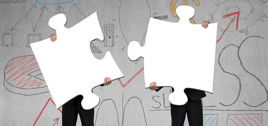 Two people holding puzzles to connect business doodles background