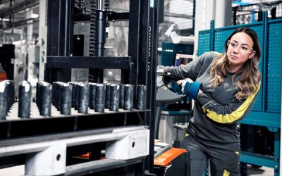 Woman working in manufacturing facility
