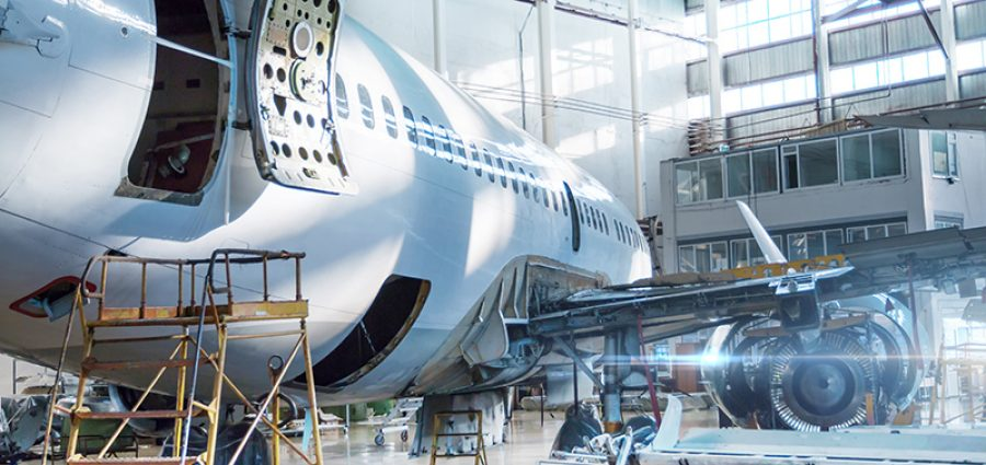 airplane being worked on in a hangar