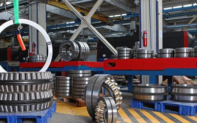 Manufacture of bearings in the factory.The chrome surface of products. Industrial theme. Production of bearings.