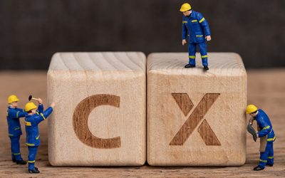 Customer Experience in product and service concept, miniature people workers with blue team uniform building cube wooden block with acronym CX on table with blackboard, user review or feedback.