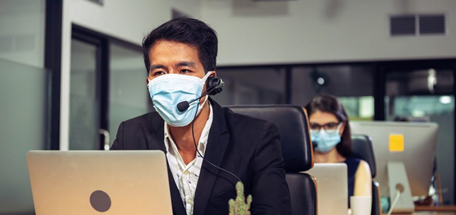Young telephone operator with headset wear protection face mask against coronavirus, Customer service executive team working at office