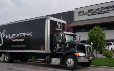 flexpak-truck-infront-of-building