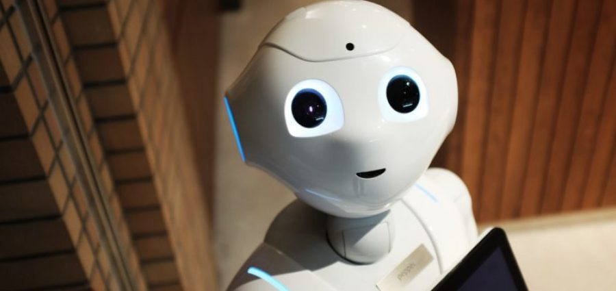 AI robot looking at camera in warehouse