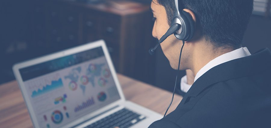 Young man calling with headset. Online lesson. Customer support