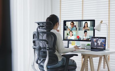 Business woman talking about sale report in video conference.Asian team using laptop and tablet online meeting in video call.Working from home,Working remotely and Self isolation at home