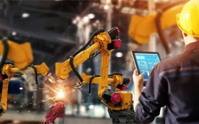 person working with robotic arms and tablet