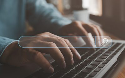 Searching Browsing Internet Data Information with blank search bar.Search Engine Optimization SEO Networking Concept.hand of businessman working with computer laptop on desk in office.