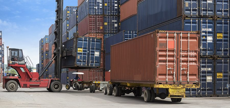 shipping crates moving at container port supply chain