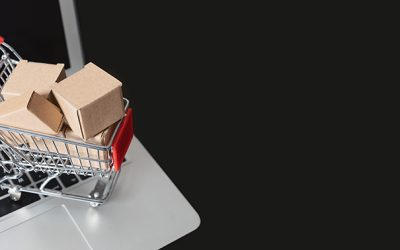 e-commerce, shopping trolley with paper boxes. Trade, selling via internet